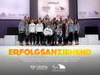 Auf dem Foto zur Präsentation der Bekleidung sind zu sehen: olympische und paralympische Sportlerinnen und Sportler sowie professionelle Models