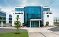 Die neuen Gebäude der weltweiten Firmenzentrale von Sandoz/Hexal, Deutschlands größtem Pharmaunternehmen, in Holzkirchen. In nur knapp zwei Jahren ist auf einem 20.000 m2 großen Grundstück ein mehrteiliger Verwaltungskomplex mit insgesamt ca. 500 Büroarbeitsplätzen entstanden.